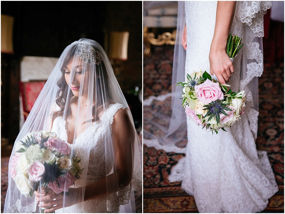 Bride looking at flowers with veil over head
