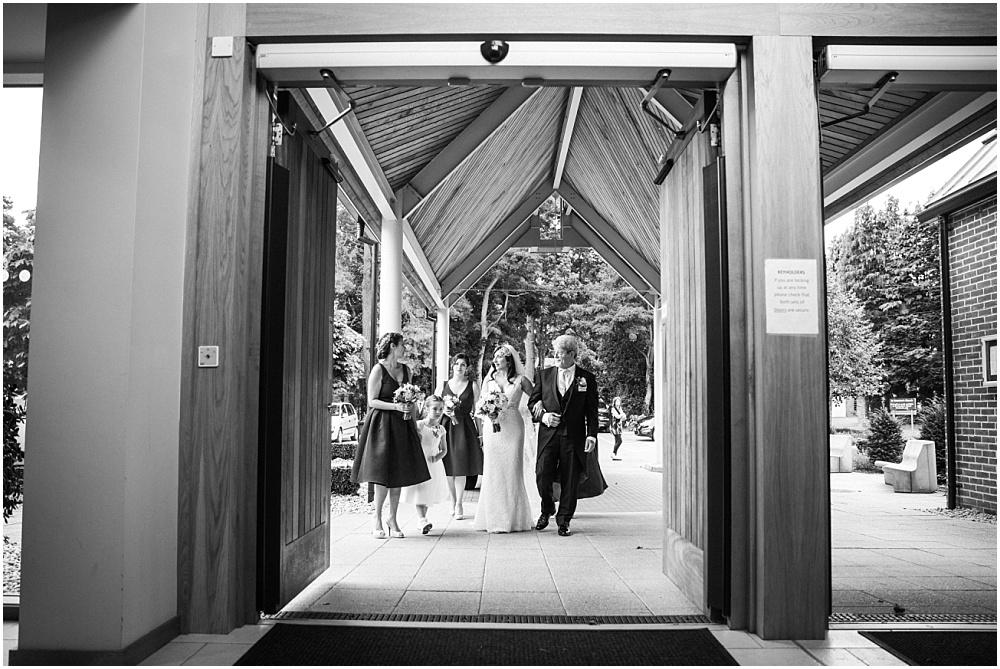 Bride arrives at st dunstans church woking