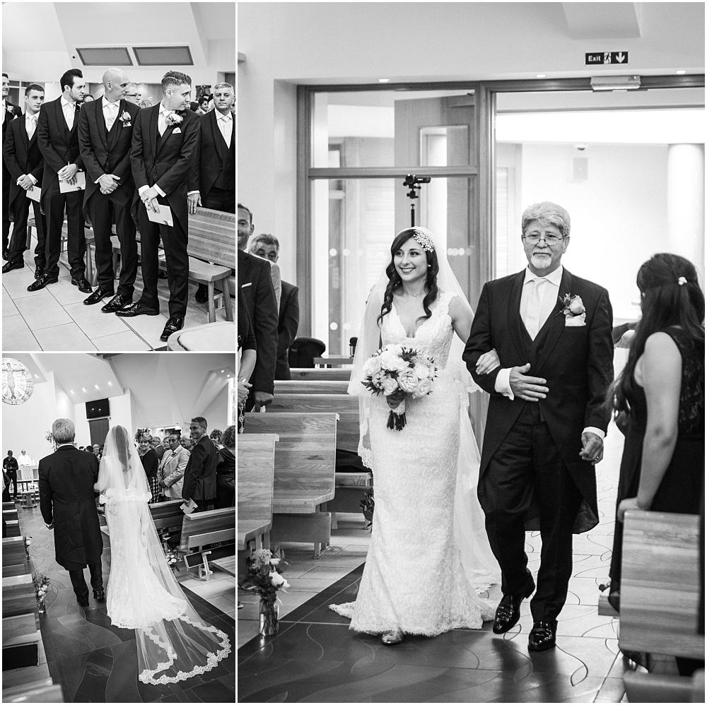 Bride walking down aisle catholic church