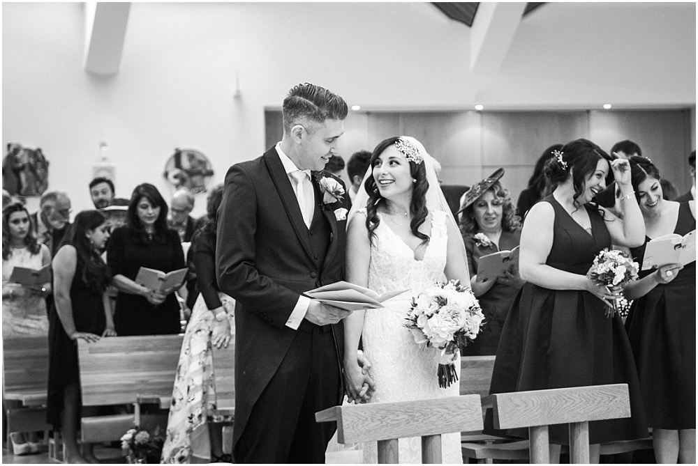 Bride and groom in st dunstans church