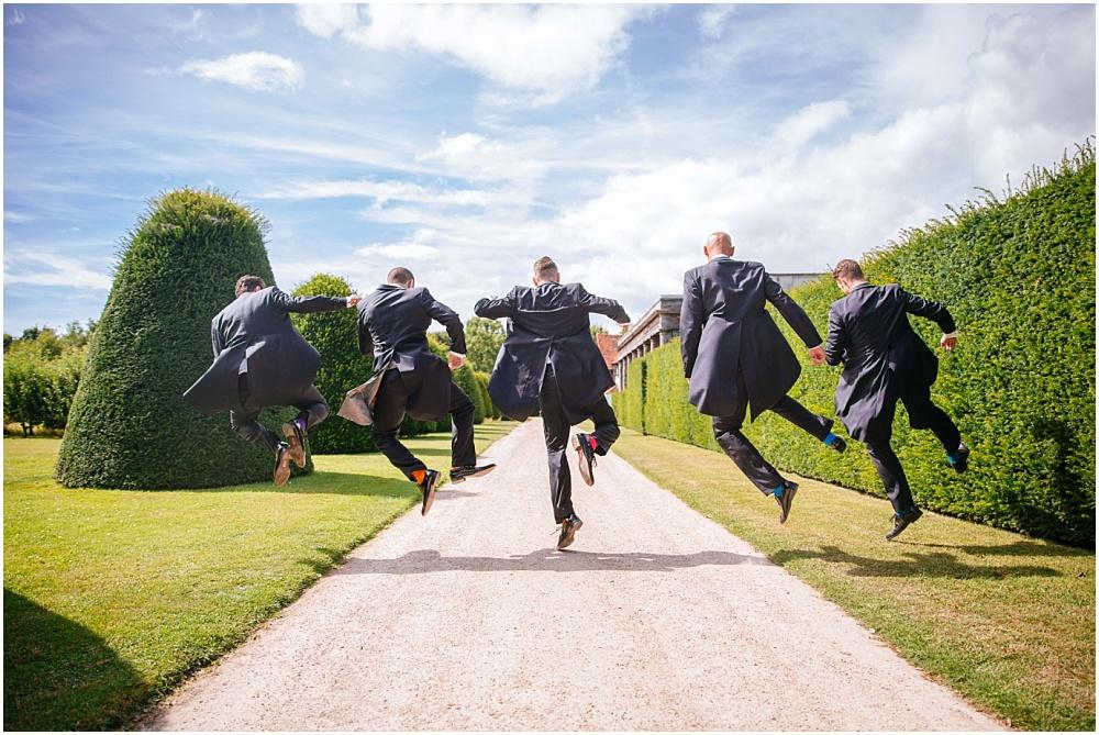 Groomsmen ushers kicking heels at great fosters