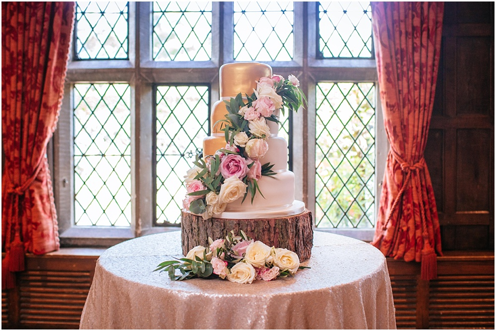 Stunning wedding cake with gold and flowers