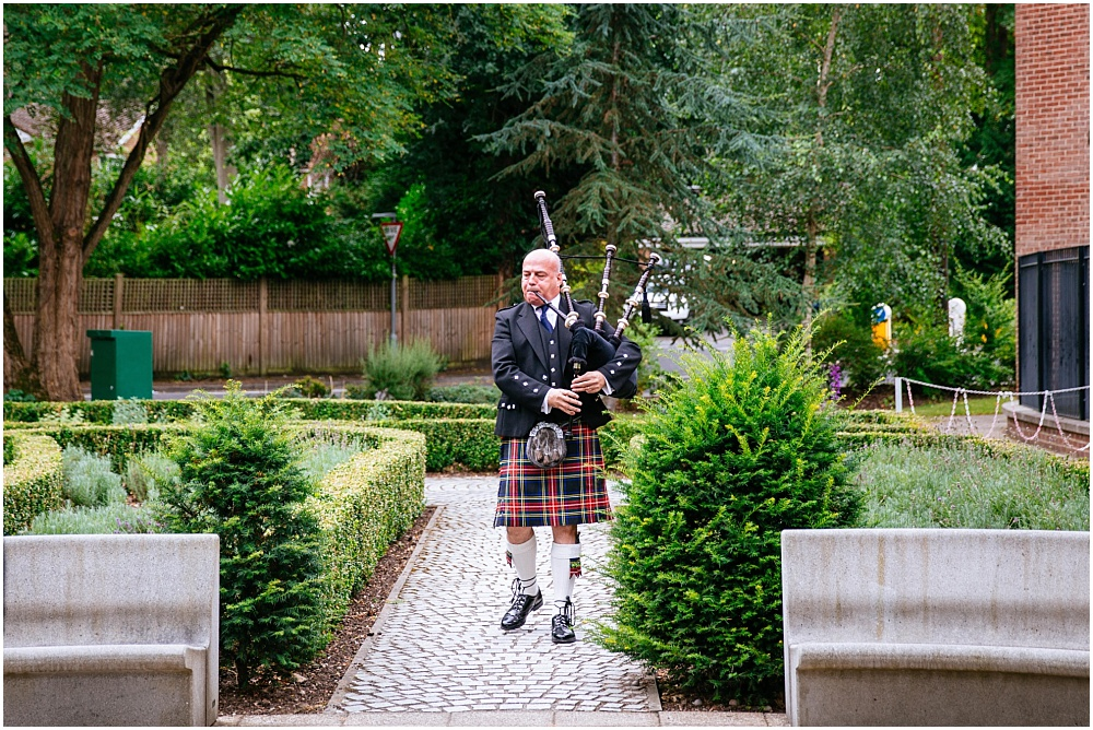 Bagpipe player outside church at wedding