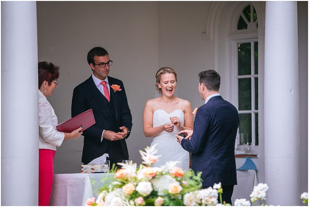 Bride laughs during wedding ceremony