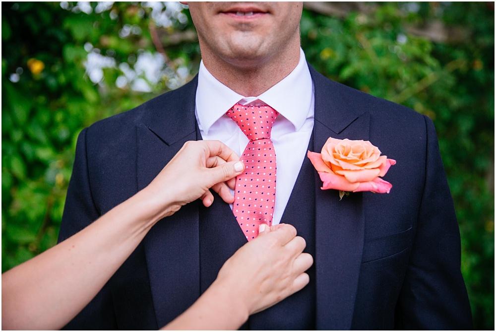Bride sorting out grooms tie