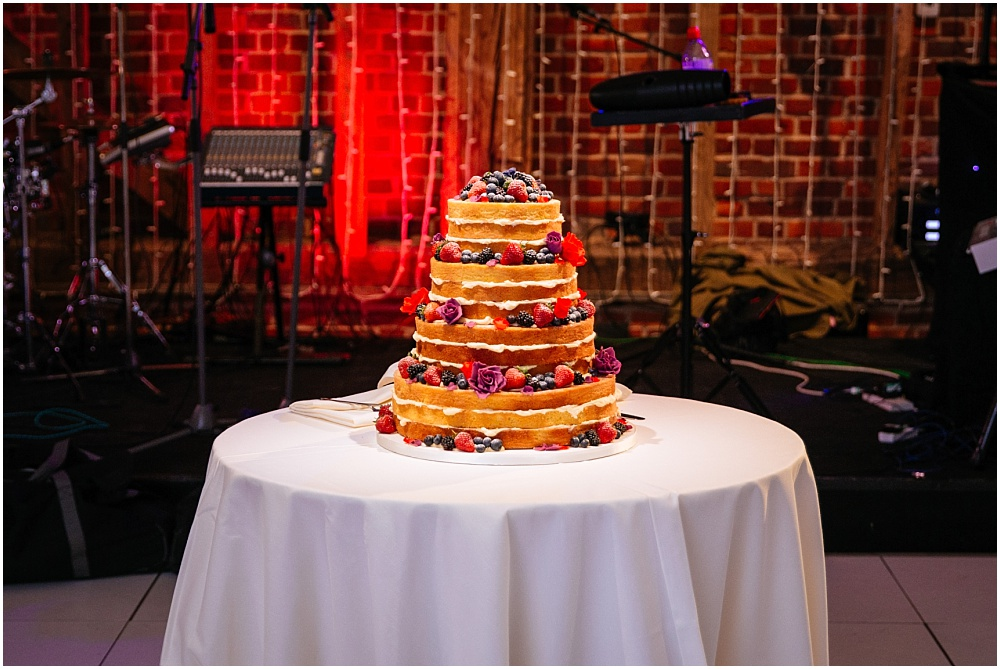 Naked wedding cake with lots of fruit