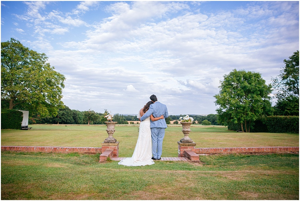 Bride and groom look at view at hertfordshire wedding venue