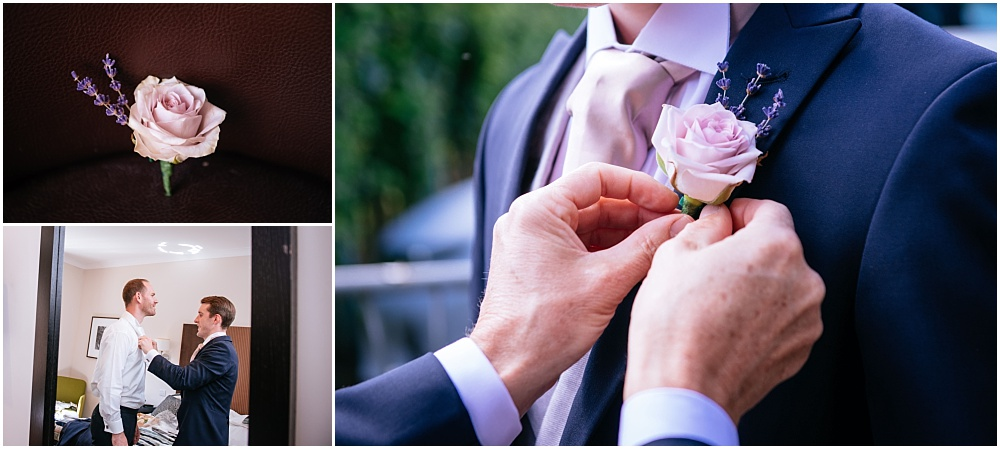 Groom having button hole put on
