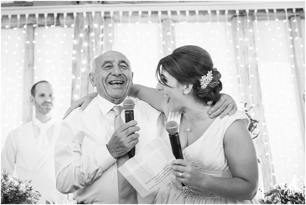 Bride singalong with grandpa at wedding