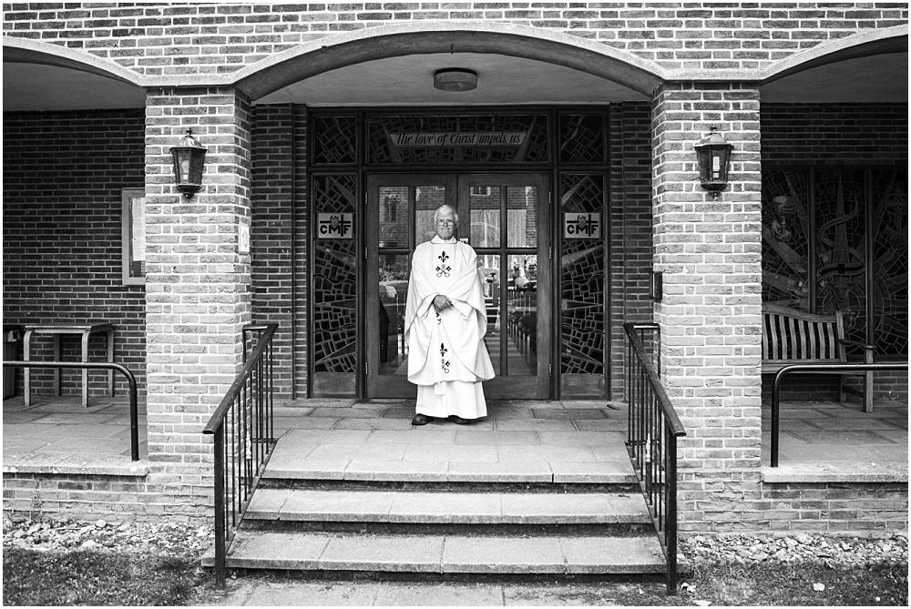 Priest outside catholic church