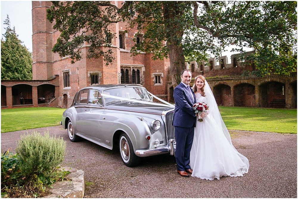 Bride and groom and bentley at childerley hall