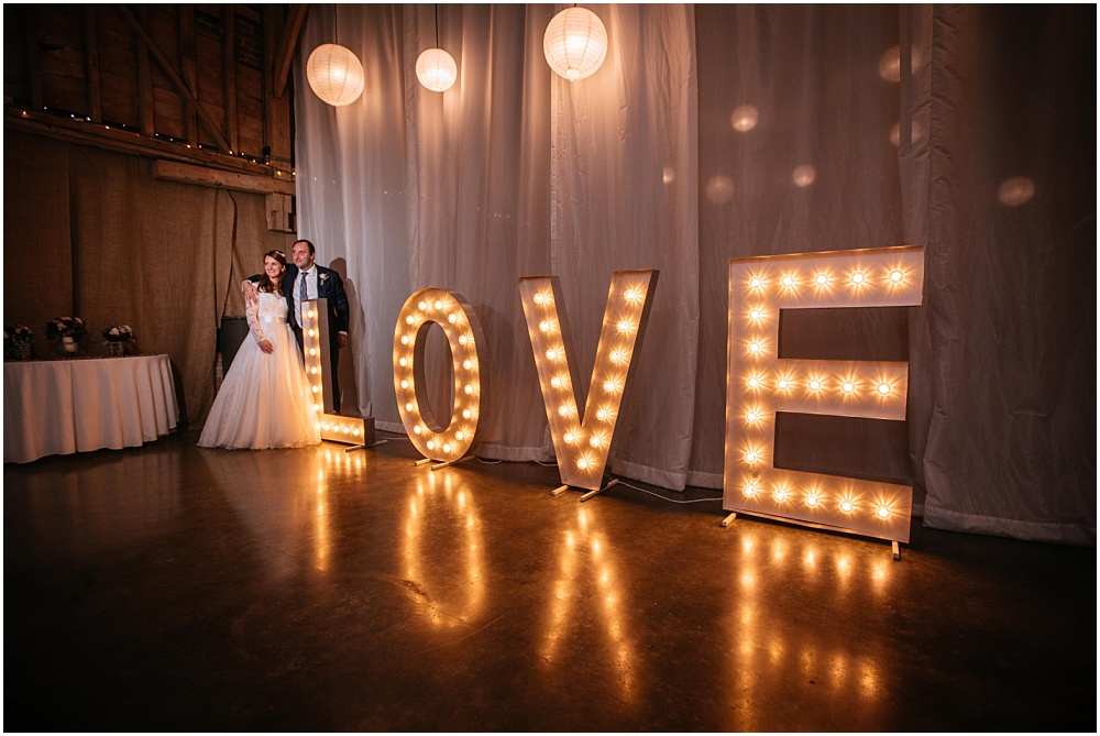 Bride and groom and light up love letters