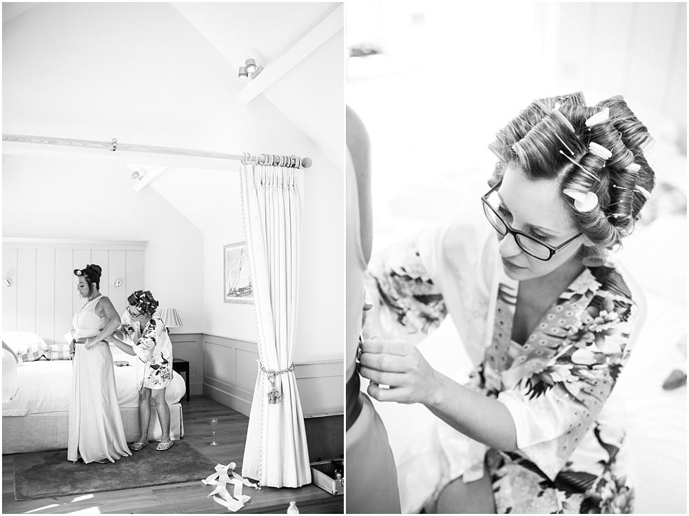 Bride helping bridesmaid