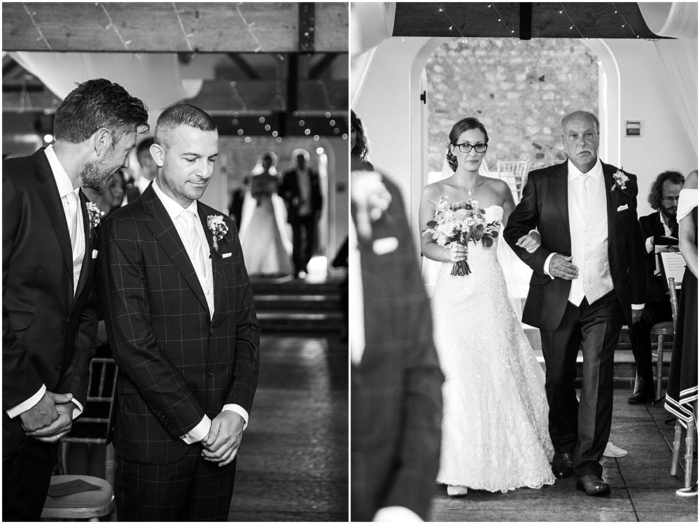 Bride walks down aisle at farbridge chichester wedding venue