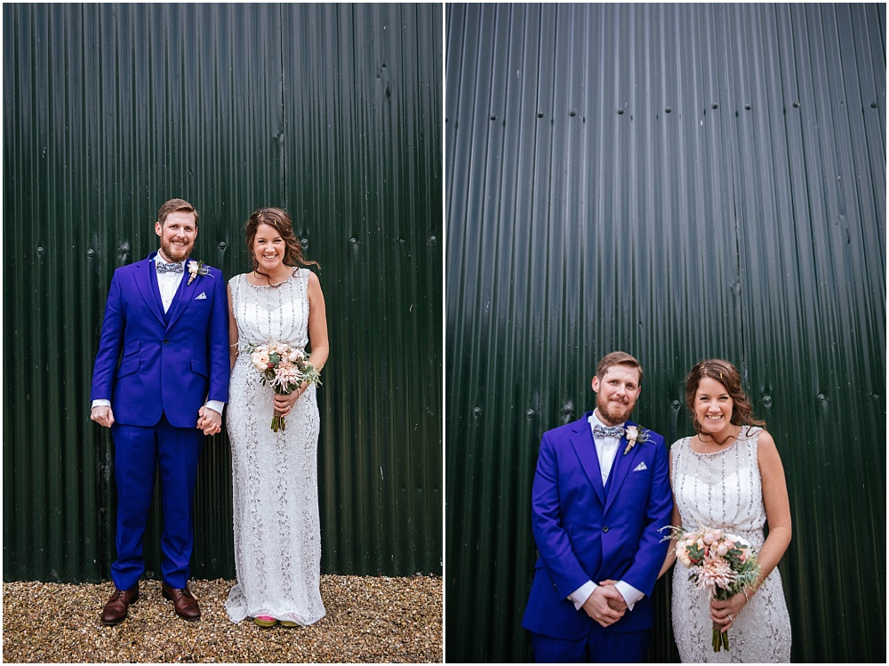 Bride and groom in front of corrugated iron