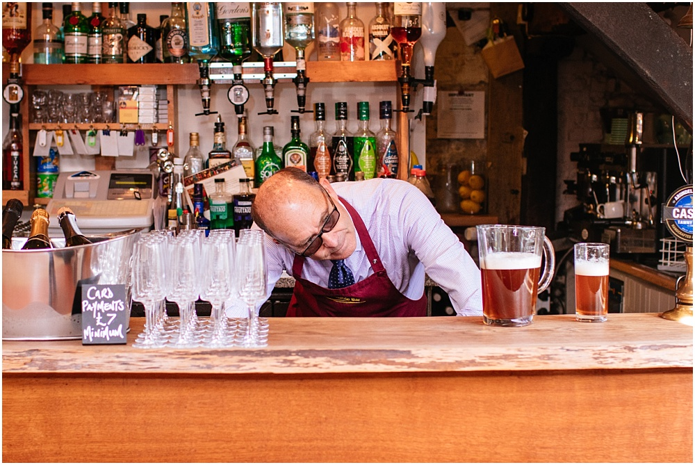 Bar man checking head
