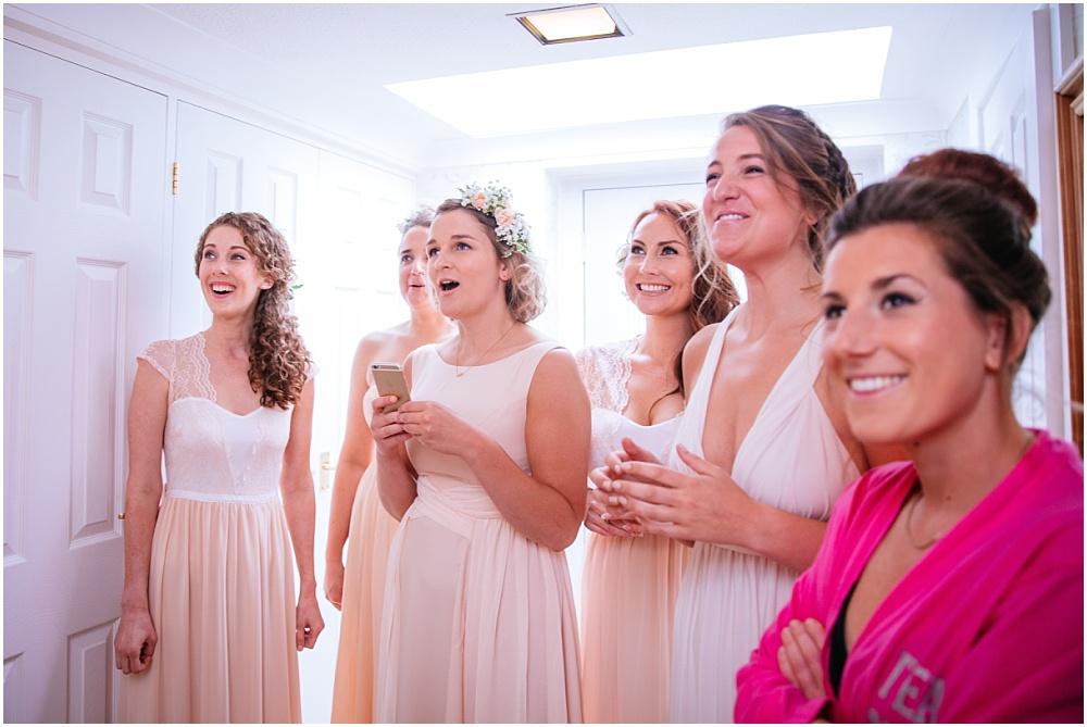 Bridesmaids gasp when see bride