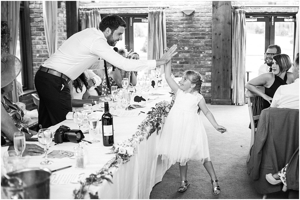 Groom and flower girl high five