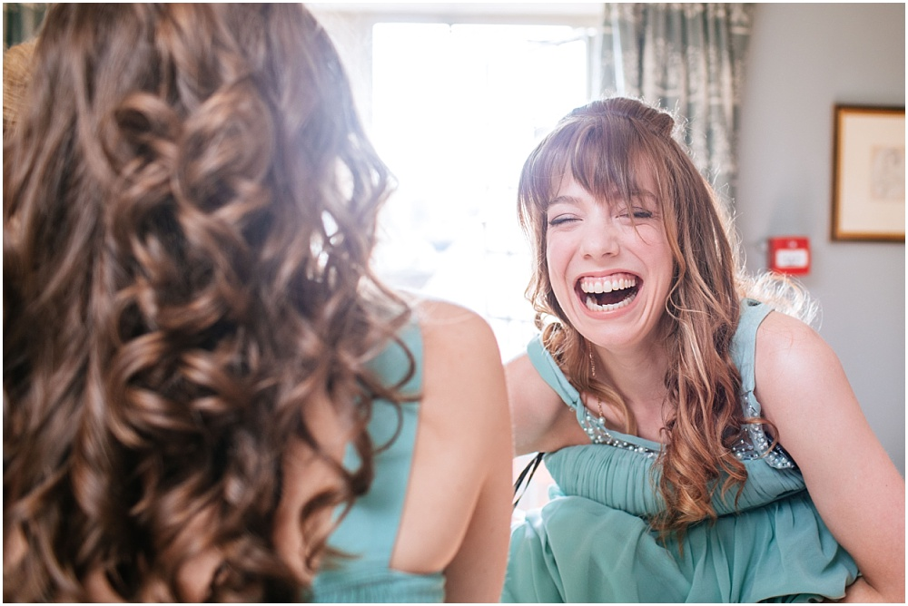 Laughing bridesmaid in turquoise dress