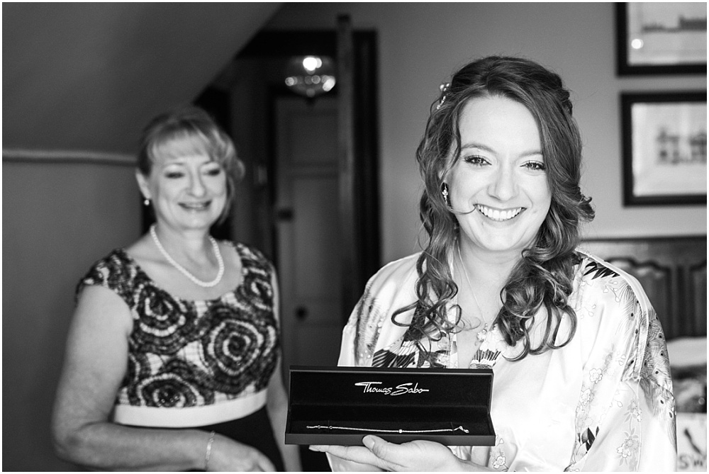 black and white photo of beautiful bride and proud mum