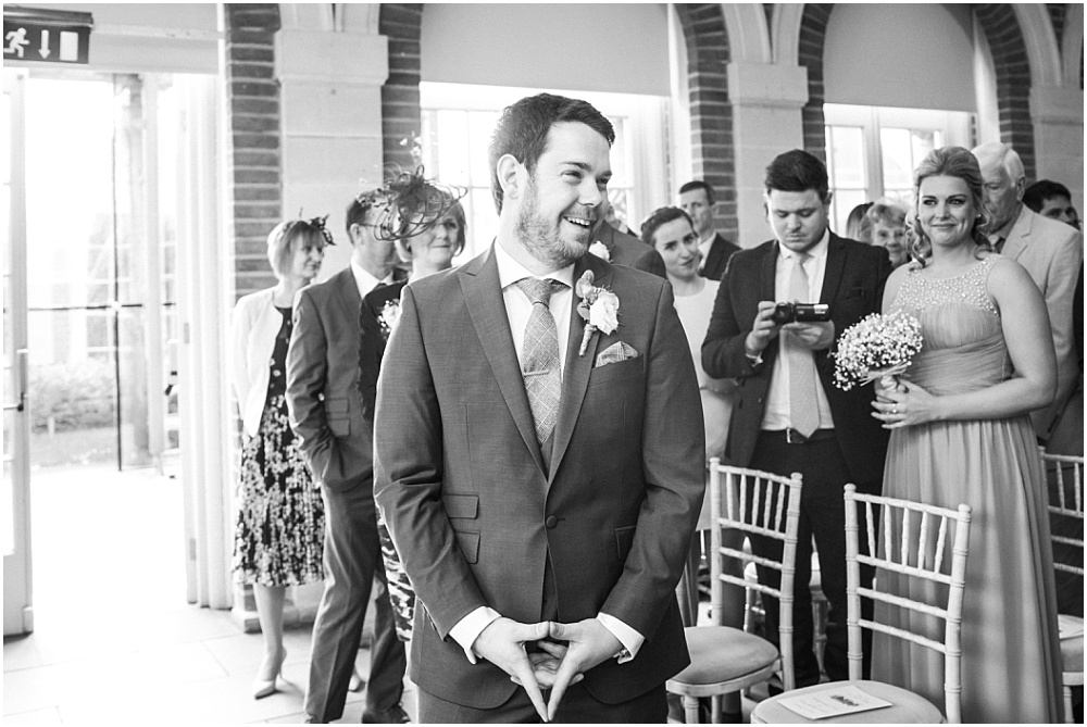 Laughing groom in black and white