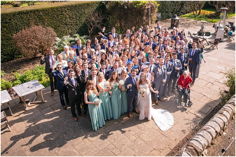 Photo of all guests from roof at great fosters wedding