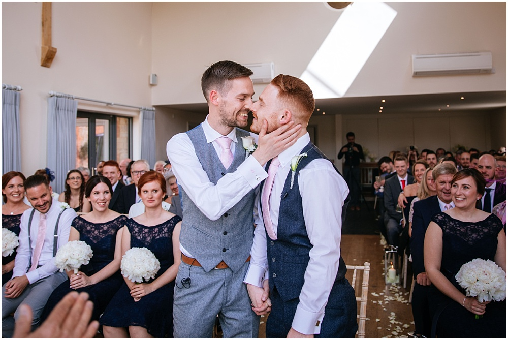 Groom and groom first married kiss