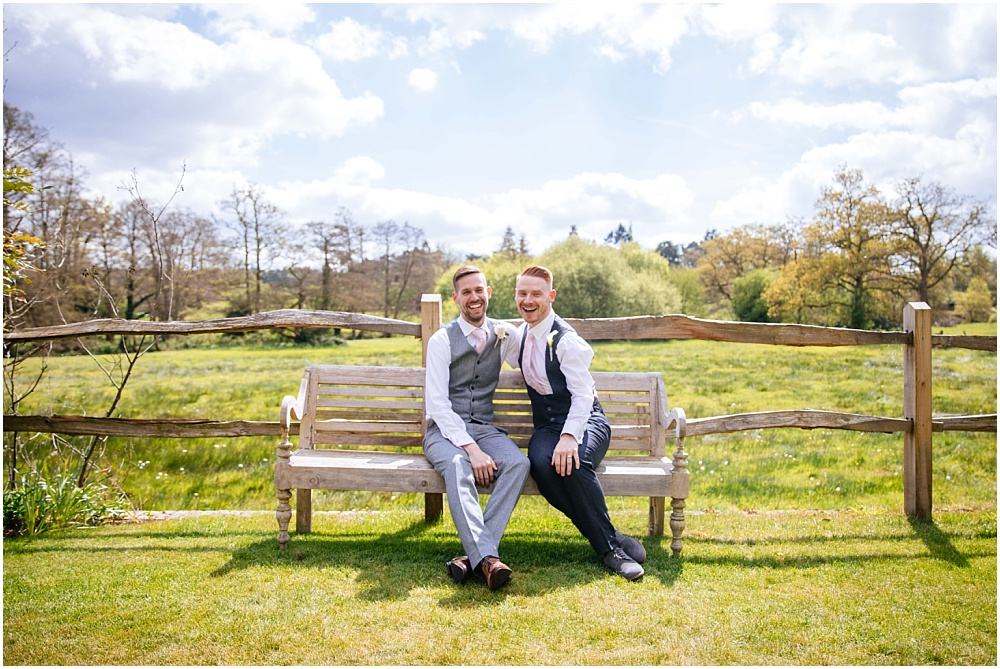 Handsome grooms sitting on millbridge court bench
