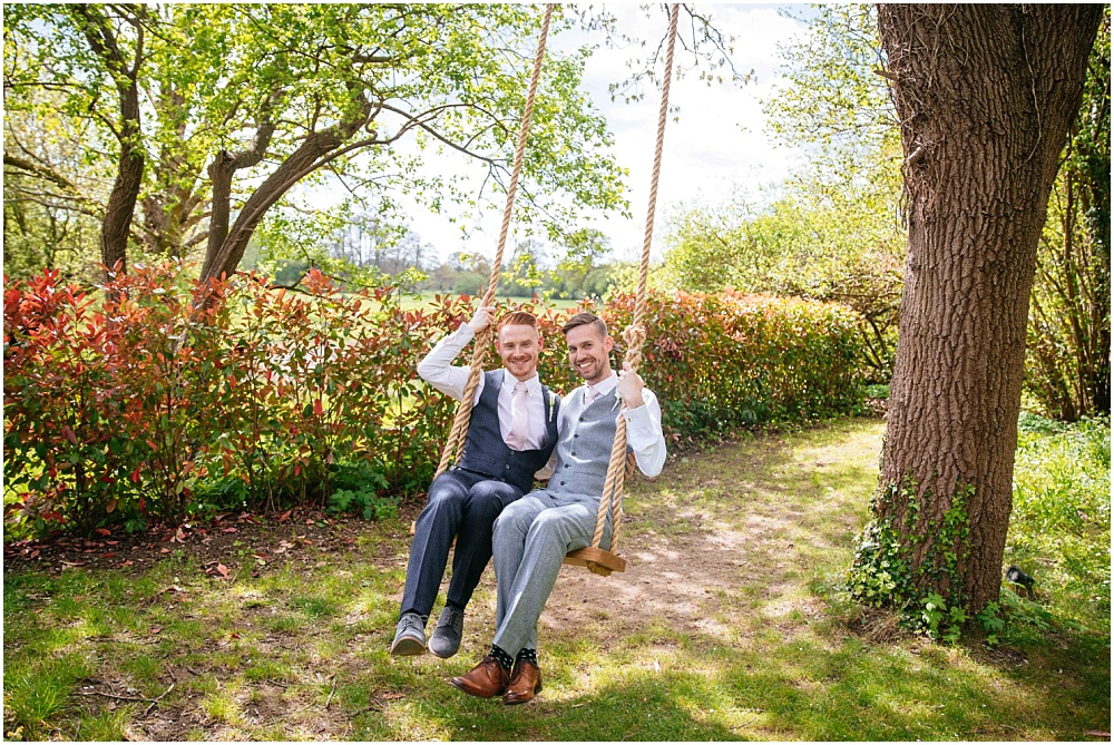 Two grooms on wedding swing