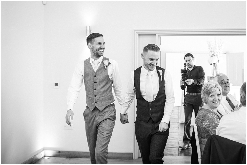 Grooms enter wedding breakfast at millbridge court