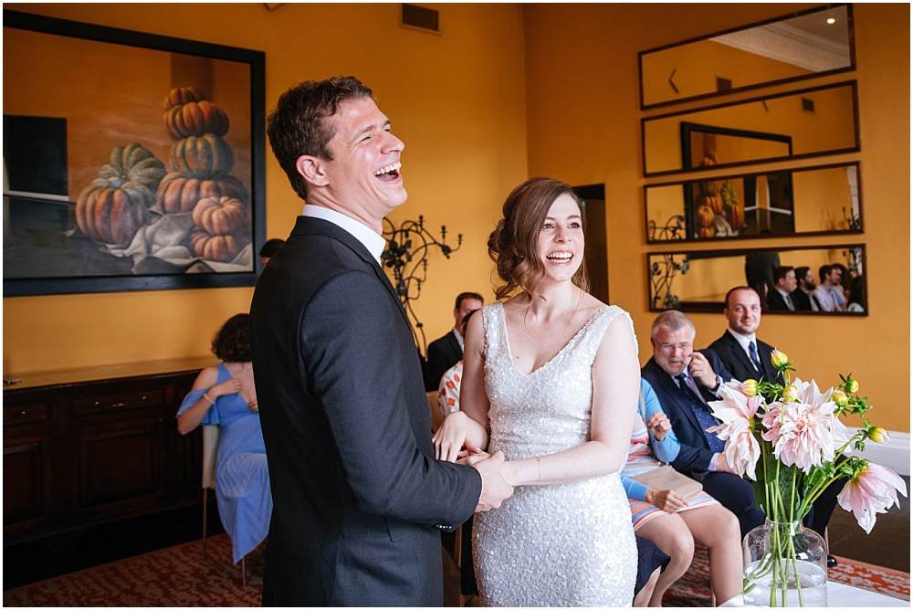 Laughing during the grove wedding ceremony