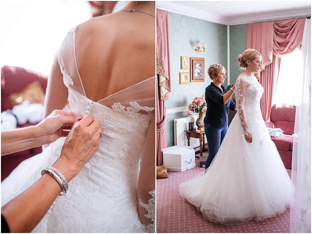 Bride getting into pronovias dress