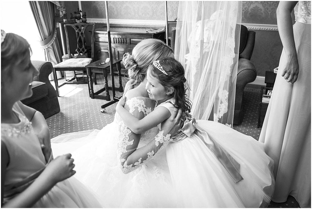 Bride hugs flower girls