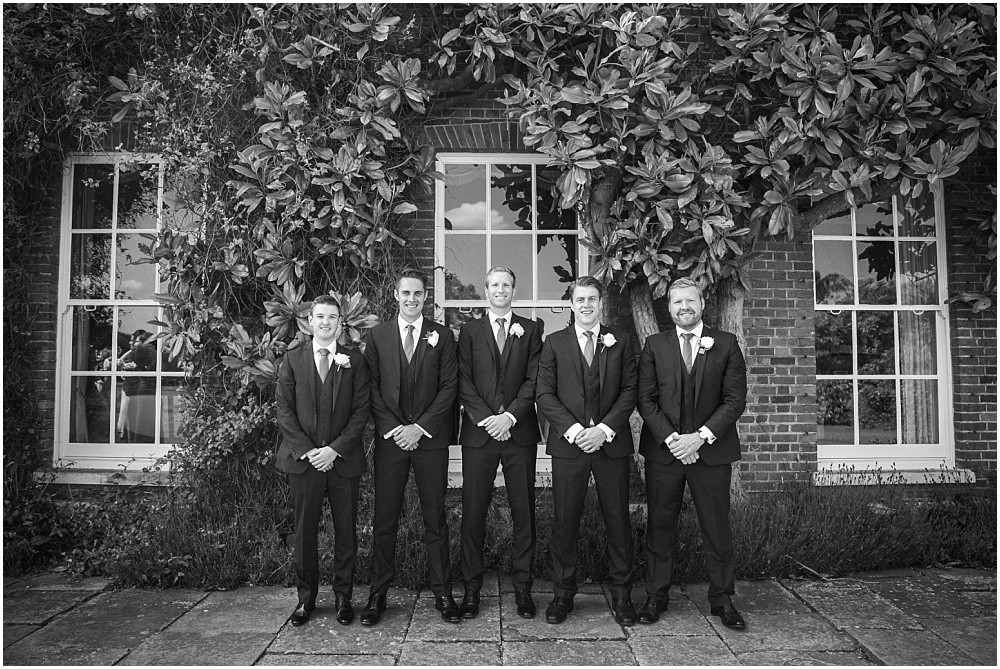 Black and white photograph of ushers