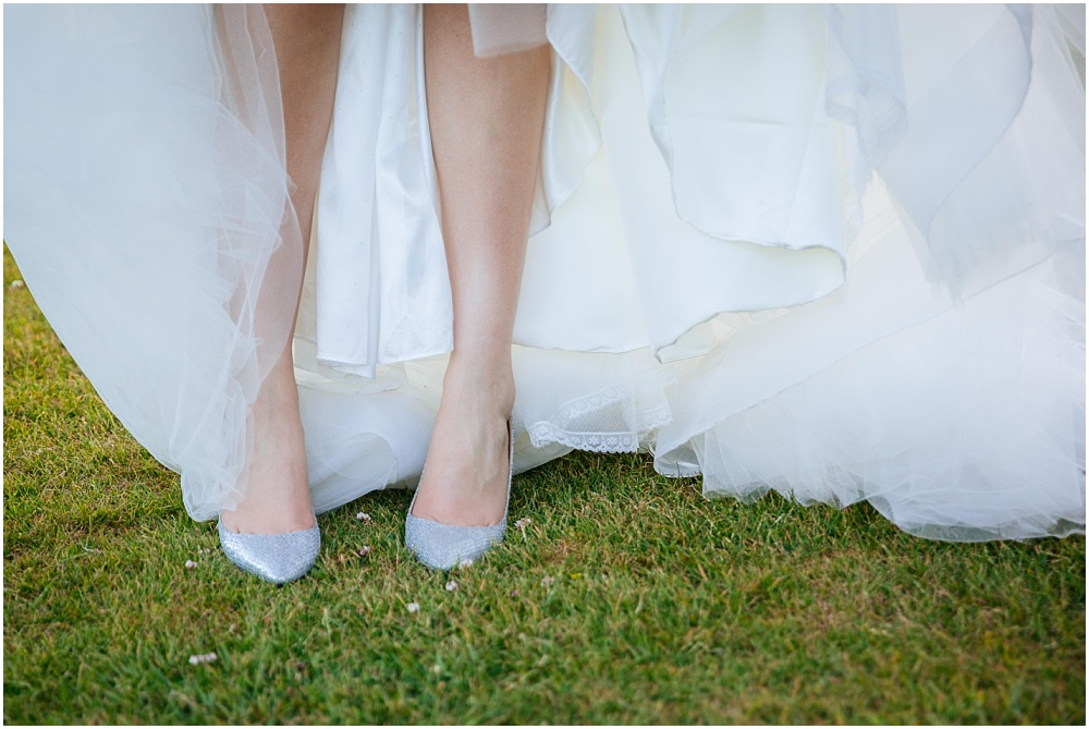 Bride with shiny wedding shoes