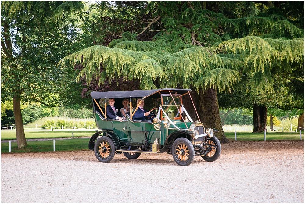 Bride and groom arrive in vintage car
