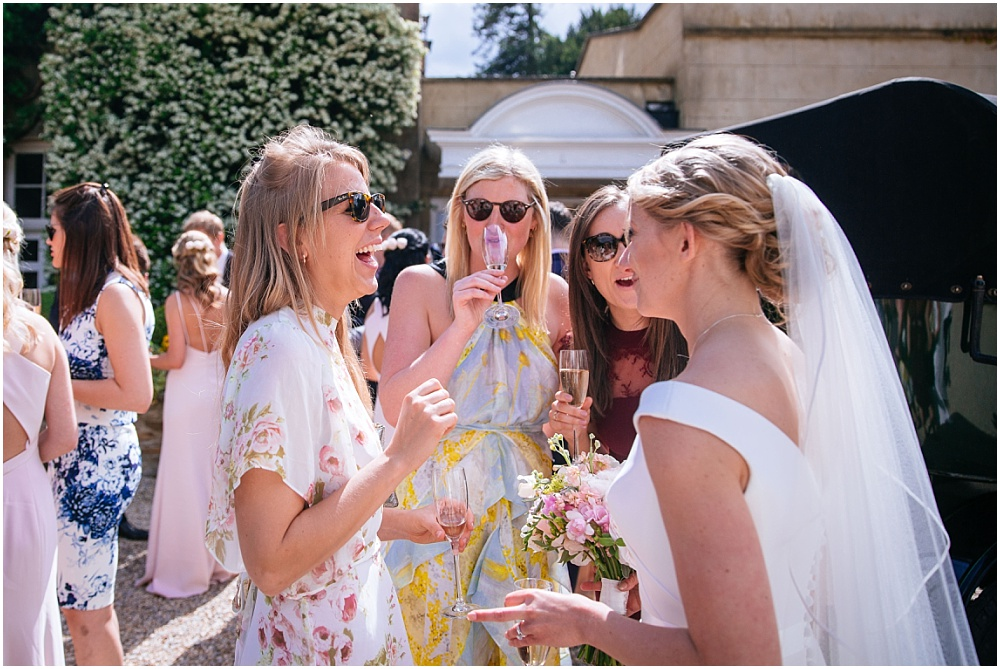 Laughing guests at surry wedding