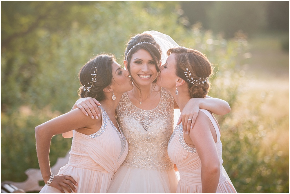 sun dappled kiss in golden hour bride bridesmaid