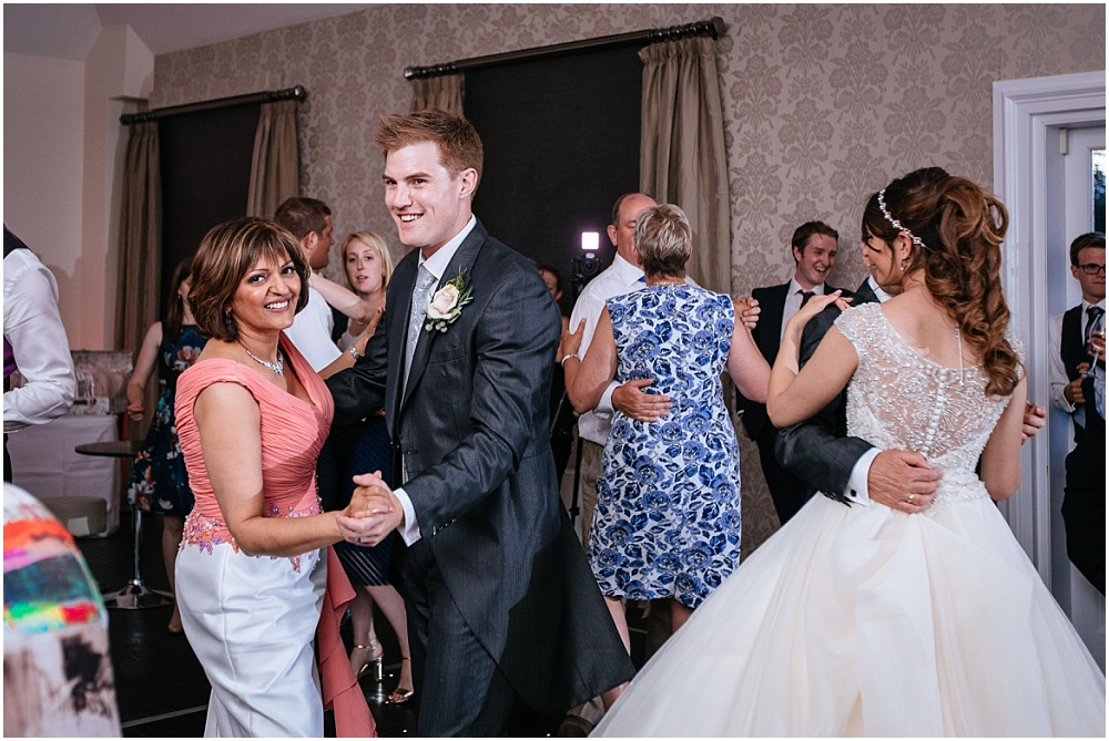 groom dances with mother of the bride