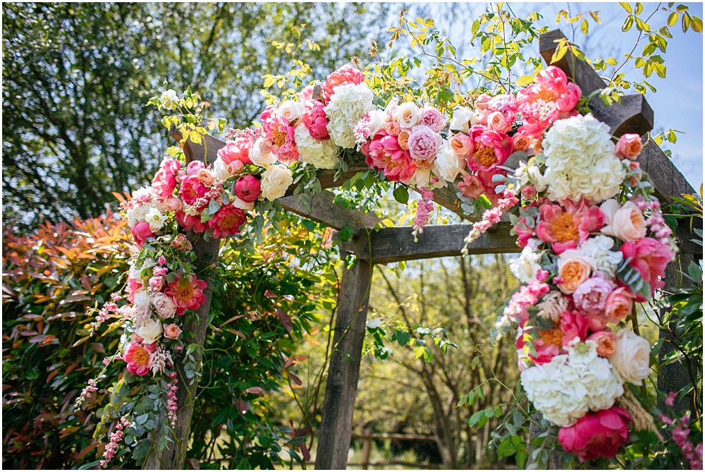 Blush floral design flower arch