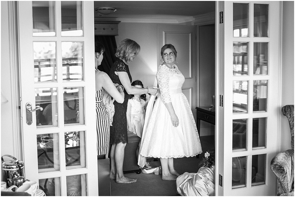 Bride getting into wedding dress in Marlow