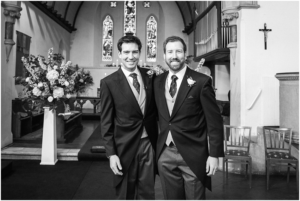 Groom and brother in black and white