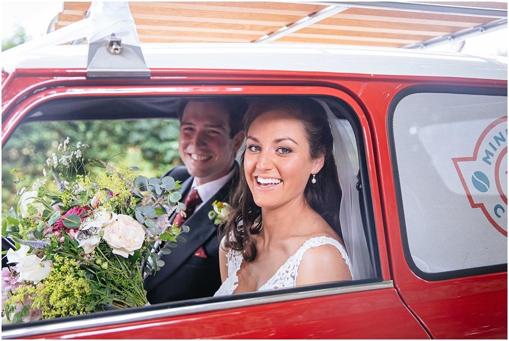 Bride and groom leave in mini bean mini