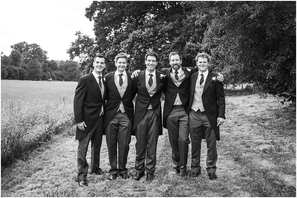 Ushers in field at wedding