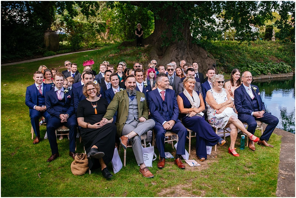 Guests watching outside wedding ceremony in Hertfordshire