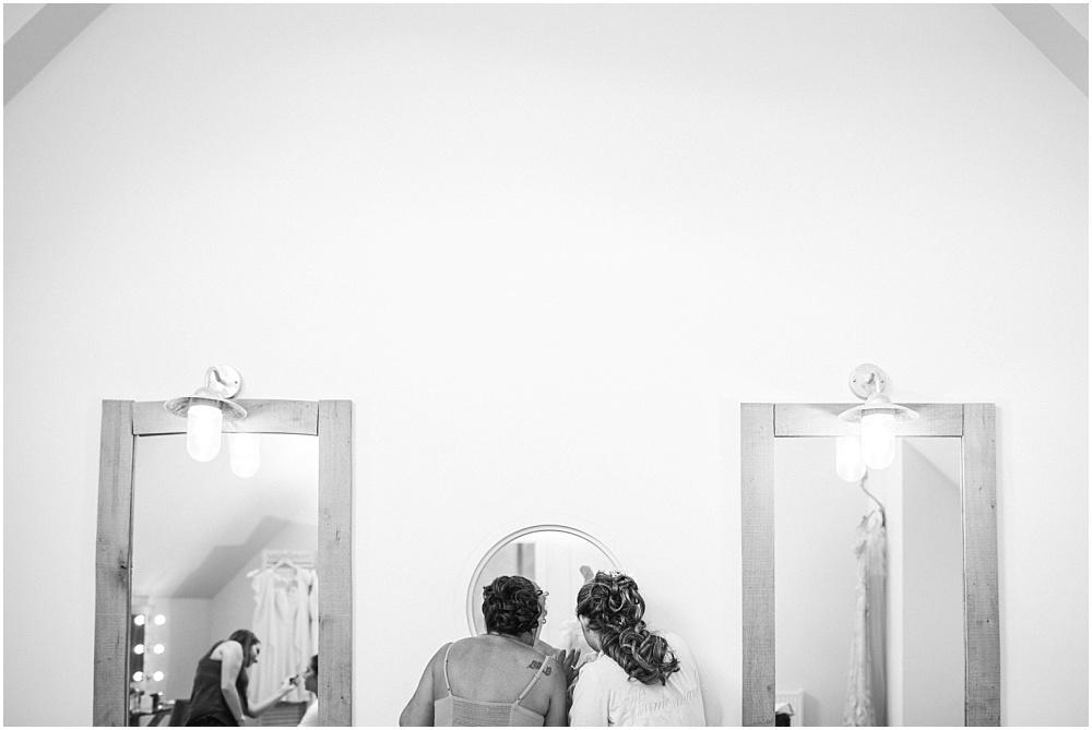 Peeking at wedding guests through one way mirror at millbridge