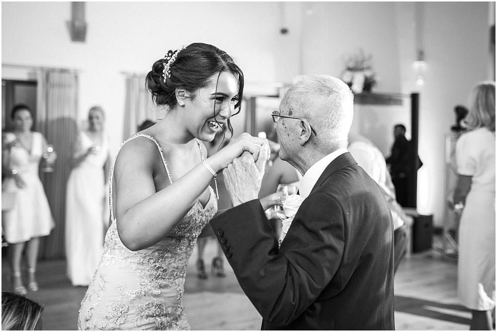 Bride dancing with grandpa
