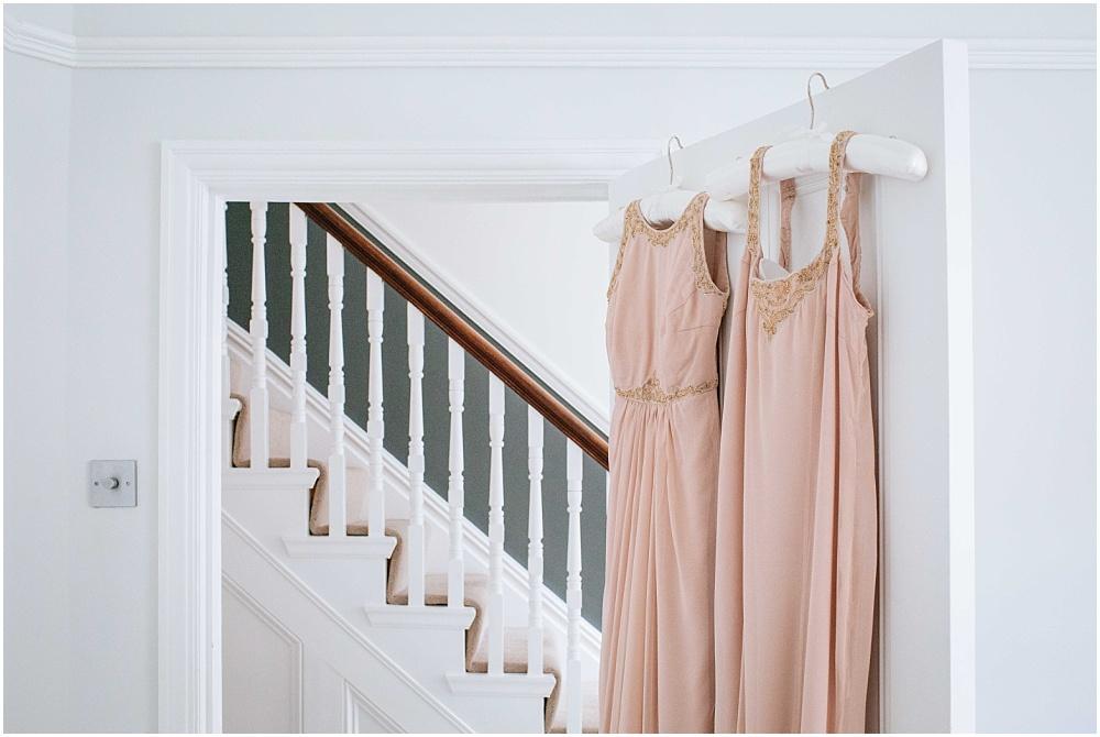 Bridesmaids dresses hanging up in barnes