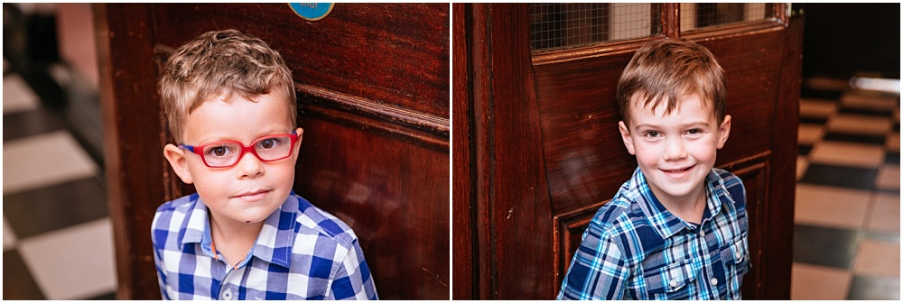 Little boys holding doors open at registry office in London