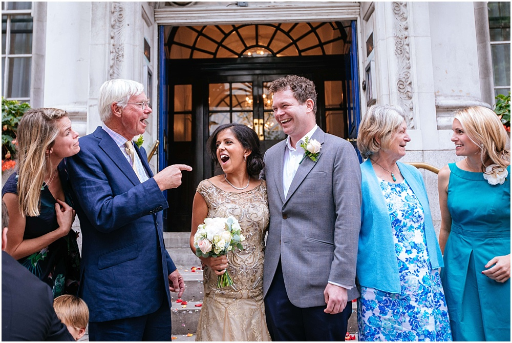 Laughing informal wedding photographs outside london registry office